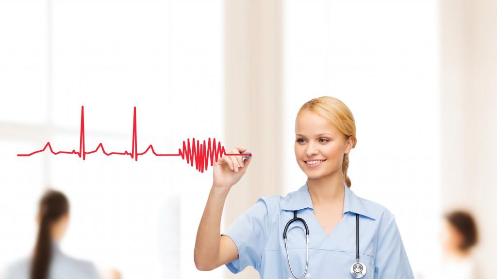 smiling doctor or nurse drawing electrocardiogram
